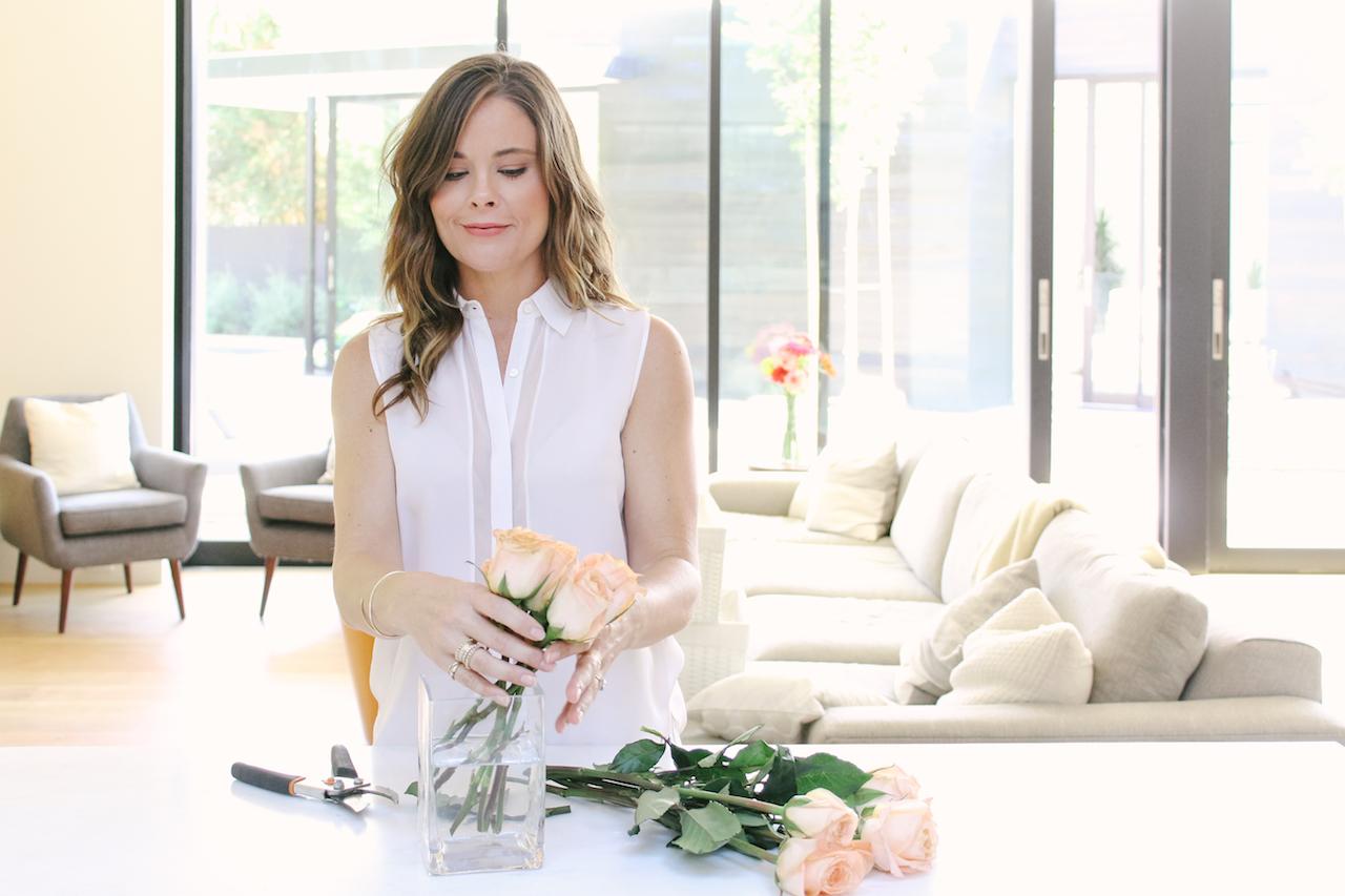 Lili arranging flowers