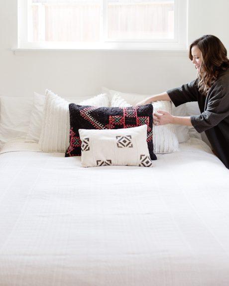Lili making bed
